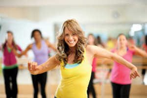 Smiling-woman-fitness-dancing-horz